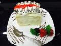 cocos, frisca si vanilie, cu blat de vanilie, glazura de cocos si decor de friscacofetarie_romanesca_torturi_prajituri_londra