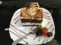 iaurt, frisca si ciocolata, cu blat de cacaco, decor de caramel si alunecofetarie_romanesca_torturi_prajituri_londra
