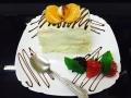 mandarine, frisca si vanilie, cu blat de vanilie, glazura de cocos si decor cu mandarinecofetarie_romanesca_torturi_prajituri_londra
