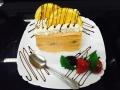 portocale, frisca si vanilie, cu blat de vanilie, glazura de portocale si decor cu portocalecofetarie_romanesca_torturi_prajituri_londra